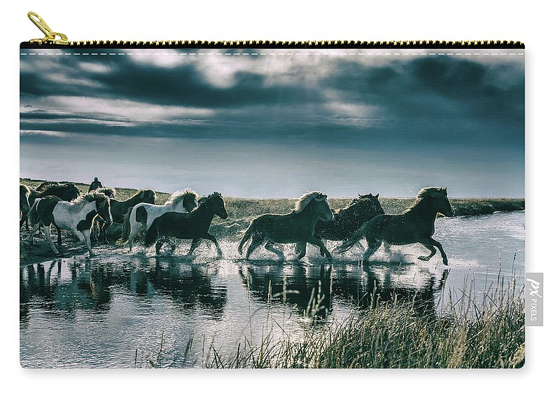 Horse Carry-all Pouch featuring the photograph Group Of Horses Crossing A River by Arctic-images