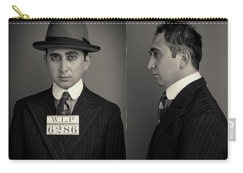 Guilt Carry-all Pouch featuring the photograph Hakan The Boss Wanted Mugshot by Nick Dolding