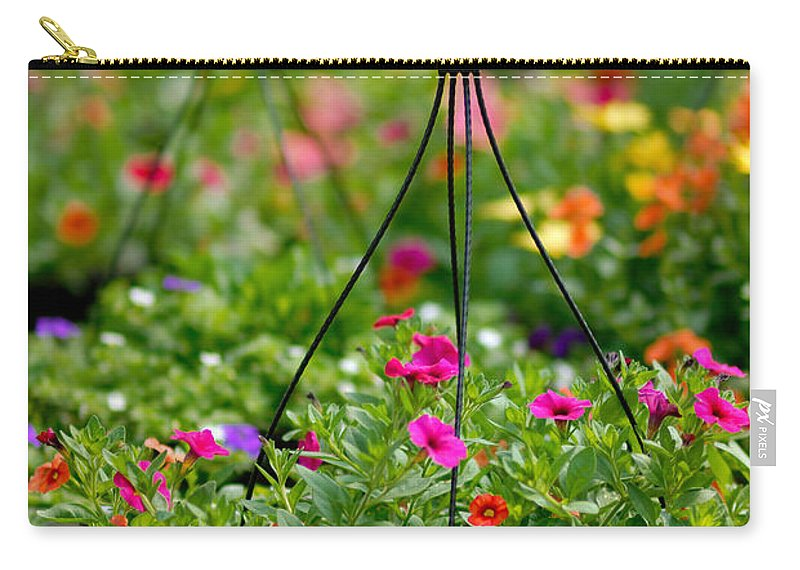 Bouquet Carry-all Pouch featuring the photograph Hanging Flower Baskets Shallow Dof by Amy Cicconi