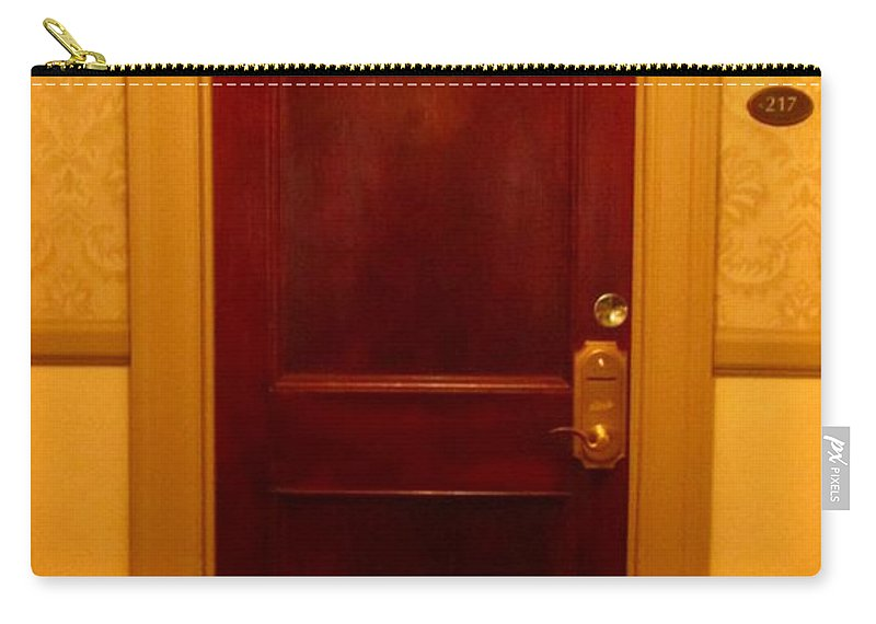 The Shining Carry-all Pouch featuring the photograph Haunted Room 217 by John Malone
