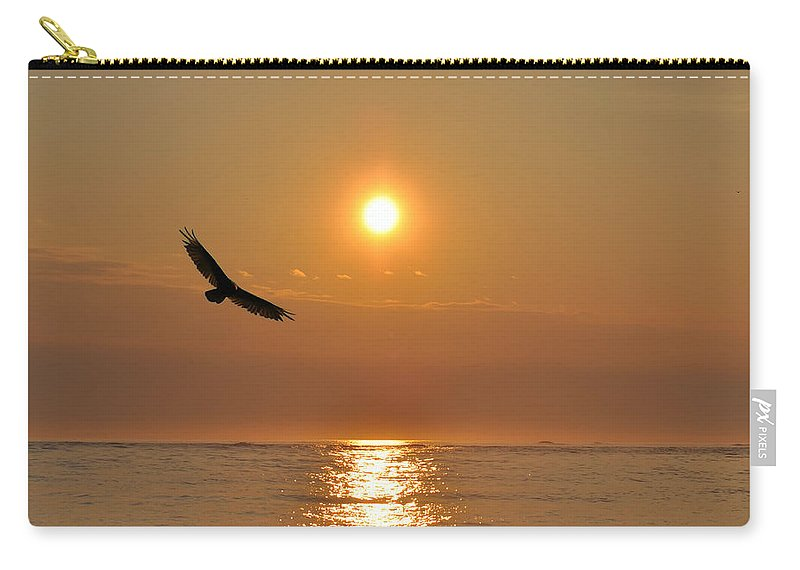 Hawk Carry-all Pouch featuring the photograph Hawk Flying At Sunrise by Bill Cannon
