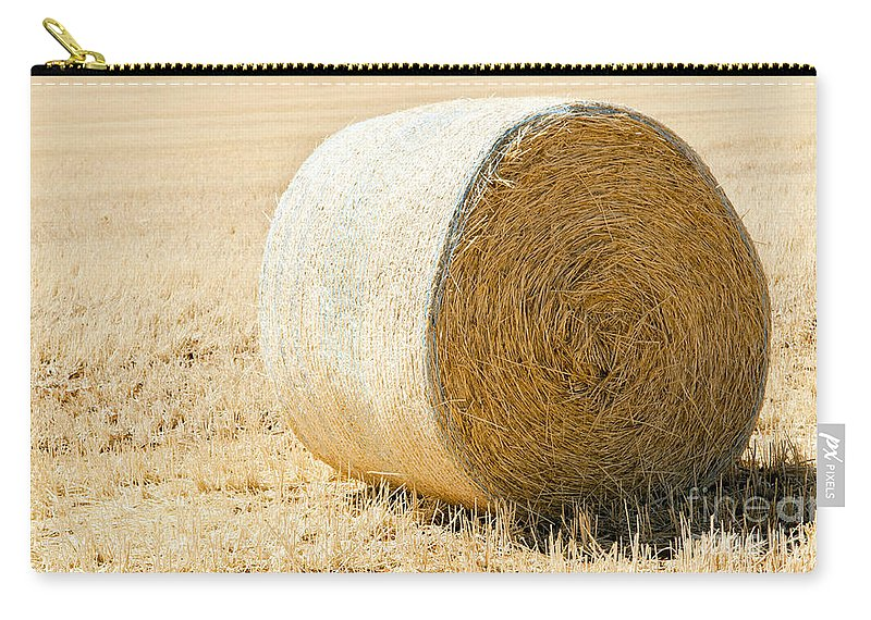 Farm Carry-all Pouch featuring the photograph Hay Bale by Tim Hester