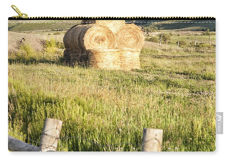 Colorado Carry-all Pouch featuring the photograph Hay Stack by Timothy Hacker
