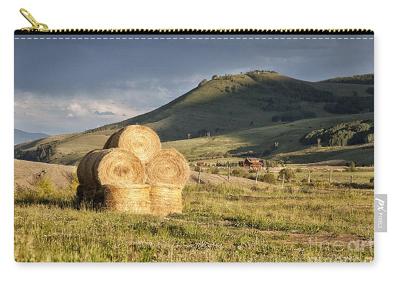 Colorado Carry-all Pouch featuring the photograph Haystack by Timothy Hacker