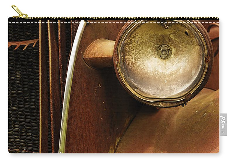 Headlight Carry-all Pouch featuring the photograph Headlight by Margie Hurwich