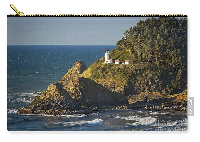 America Carry-all Pouch featuring the photograph Heceta Head Lighthouse - Sunny by Brian Jannsen
