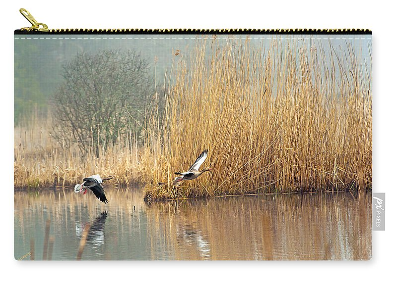 Hit The Road...! Carry-all Pouch featuring the photograph Hit The Road by Torbjorn Swenelius