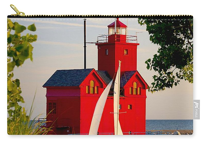 Attraction Carry-all Pouch featuring the photograph Holland Lighthouse by Nick Zelinsky