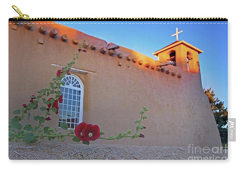 Hollyhocks On Adobe Carry-all Pouch featuring the photograph Hollyhocks On Adobe by Gary Holmes