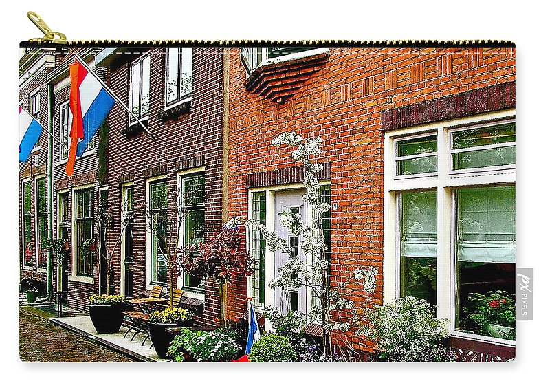 Homes Along The Canal In Zuiderzee Open Air Musuem In Enkhuizen Carry-all Pouch featuring the photograph Homes Along The Canal In Enkhuizen-netherlands by Ruth Hager