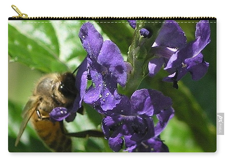 Purple Carry-all Pouch featuring the photograph Honey Bee On Purple Flower by Mary Deal