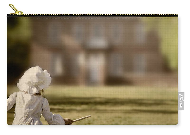 Caucasian; Girl; Little; Female; Toddler; Child; Children; Colonial; Williamsburg; Mansion; Gentry; Wealthy; Yard; Garden; Play; Playing; Toy; Hoop; Spin; Run; Running; Dress; Hat; Bonnet; Blur; Blurred; Blurry; Out Of Focus; Summer; Spring; Green; Grass; Park; Fun Carry-all Pouch featuring the photograph Hoop by Margie Hurwich