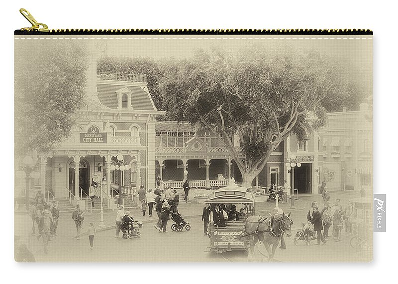 Disney Carry-all Pouch featuring the photograph Horse And Trolley Turning Main Street Disneyland Heirloom by Thomas Woolworth