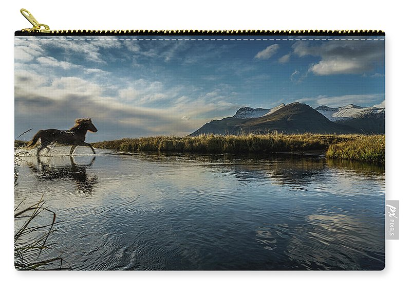 Majestic Carry-all Pouch featuring the photograph Horse Crossing A River, Iceland by Arctic-images