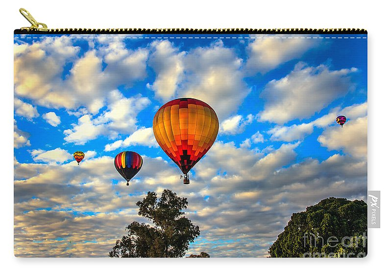 Arizonia Carry-all Pouch featuring the photograph Hot Air Balloons Over Trees by Robert Bales