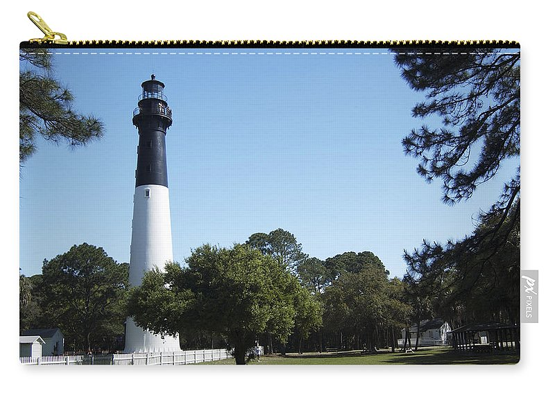 Hunting Island Lighthouse Carry-all Pouch featuring the photograph Hunting Island Lighthouse Sc by Bob Pardue