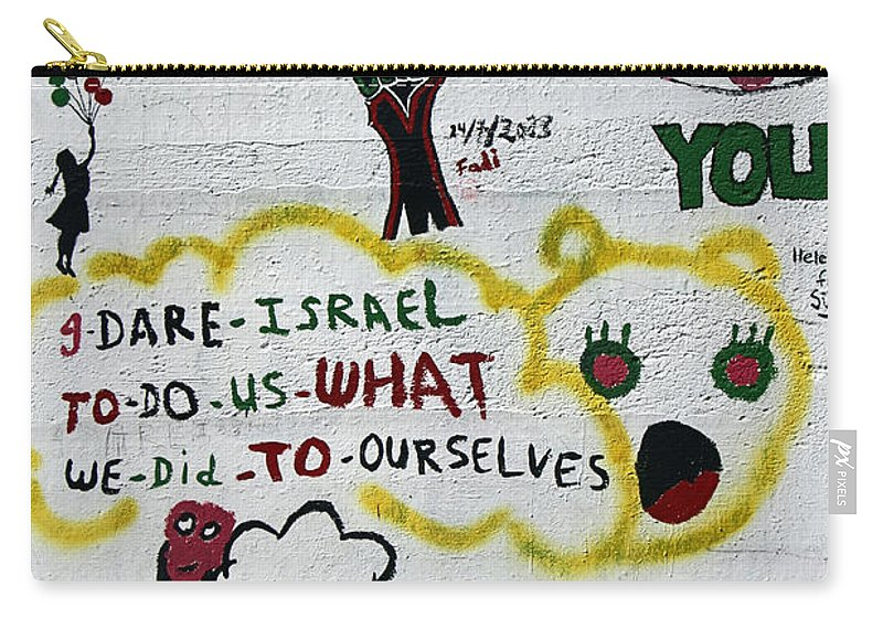 Apartheid Wall Carry-all Pouch featuring the photograph I Dare by Munir Alawi