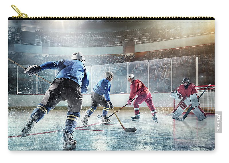 Sports Helmet Carry-all Pouch featuring the photograph Ice Hockey Players In Action by Dmytro Aksonov