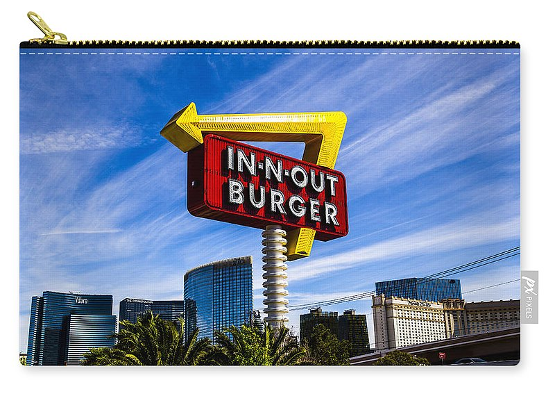 Nevada Carry-all Pouch featuring the photograph In N Out by Angus Hooper Iii