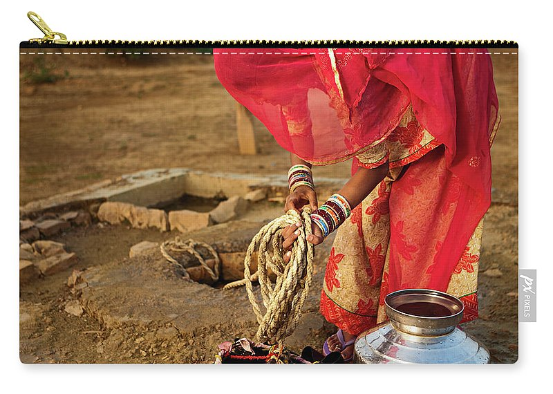 Working Carry-all Pouch featuring the photograph Indian Woman Getting Water From The by Hadynyah