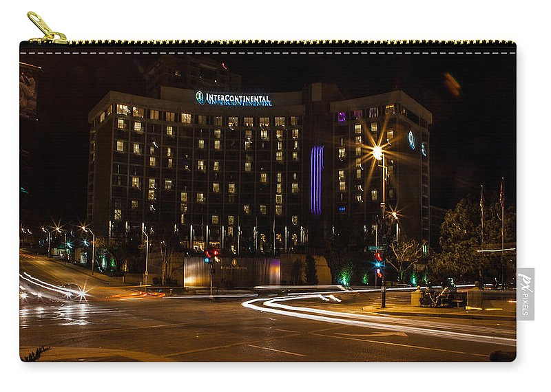 Slow Speed Carry-all Pouch featuring the photograph Intercontinental Hotel by Sennie Pierson