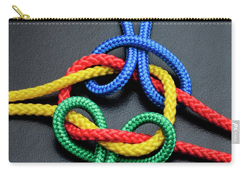 Teamwork Carry-all Pouch featuring the photograph Intertwined Multicolored Ropes by Jorg Greuel