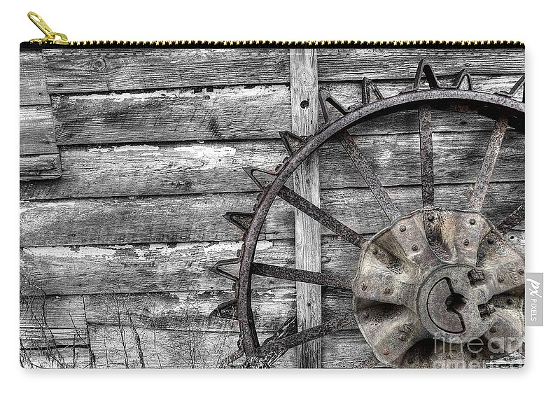 Coosaw Carry-all Pouch featuring the photograph Iron Tractor Wheel by Scott Hansen