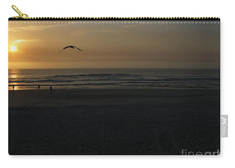 Florida Sunrise Carry-all Pouch featuring the photograph It Starts by Greg Patzer