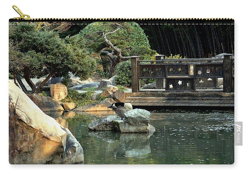 Japanese Garden At Sundown Carry-all Pouch featuring the photograph Japanese Garden At Sundown by Maria Urso
