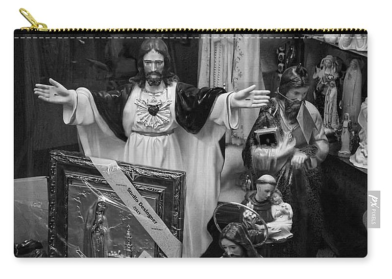 Art Carry-all Pouch featuring the photograph Jesus With Arms Wide Open Religious Figurines In A Shop Window In Toronto by Randall Nyhof