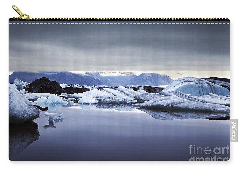Jokulsarlon Carry-all Pouch featuring the photograph Jokulsarlon by Gunnar Orn Arnason