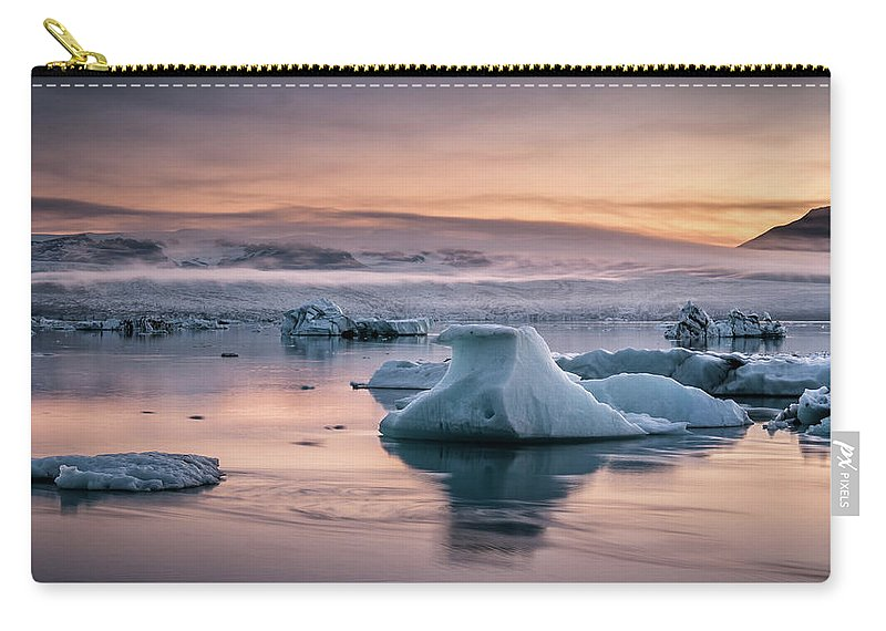 Scenics Carry-all Pouch featuring the photograph Jokulsarlon Sunrise by Andreas Wonisch