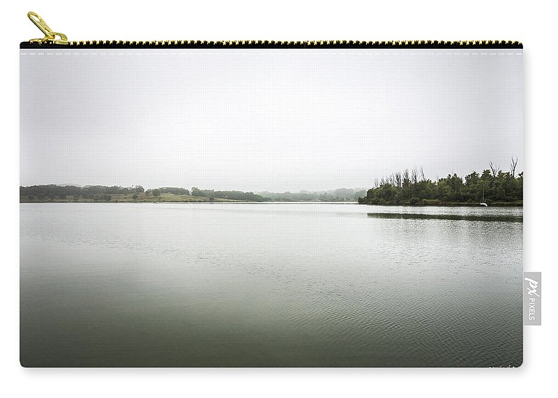 Glenn Cunningham Lake Carry-all Pouch featuring the photograph Just A Boat by Edward Peterson