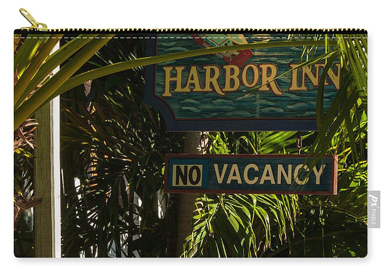 Architecture Carry-all Pouch featuring the photograph Key West Harbor Inn Sign by Ed Gleichman