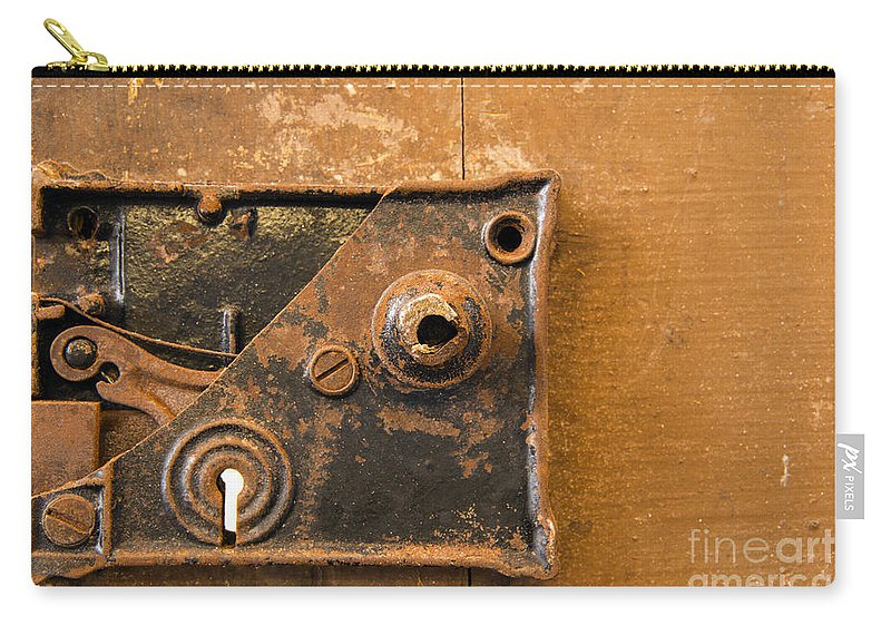 Lock Mechanism Carry-all Pouch featuring the photograph Keyhole     by Bob Phillips