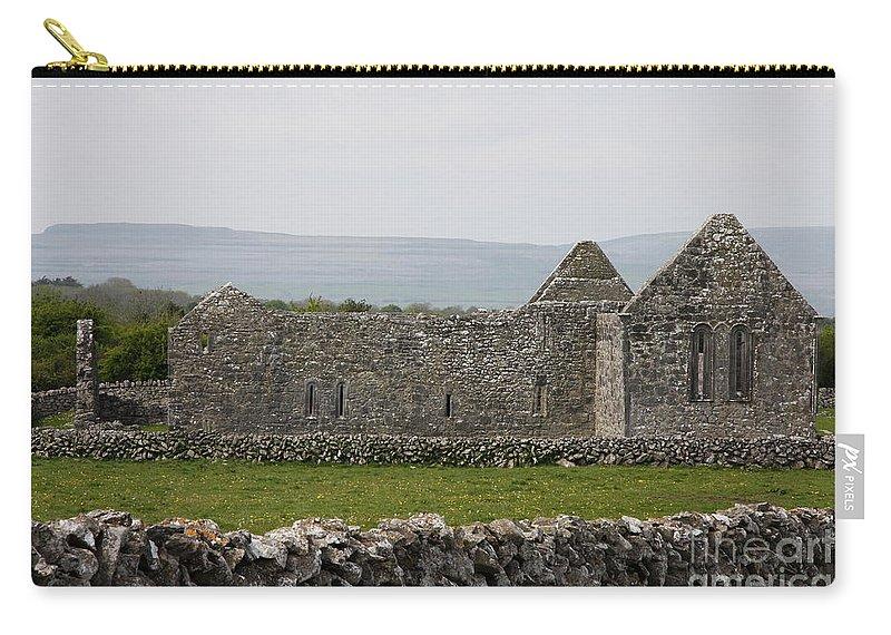 Kilmacduagh Church Ruin Carry-all Pouch featuring the photograph Kilmacduagh Church Ruin by Christiane Schulze Art And Photography