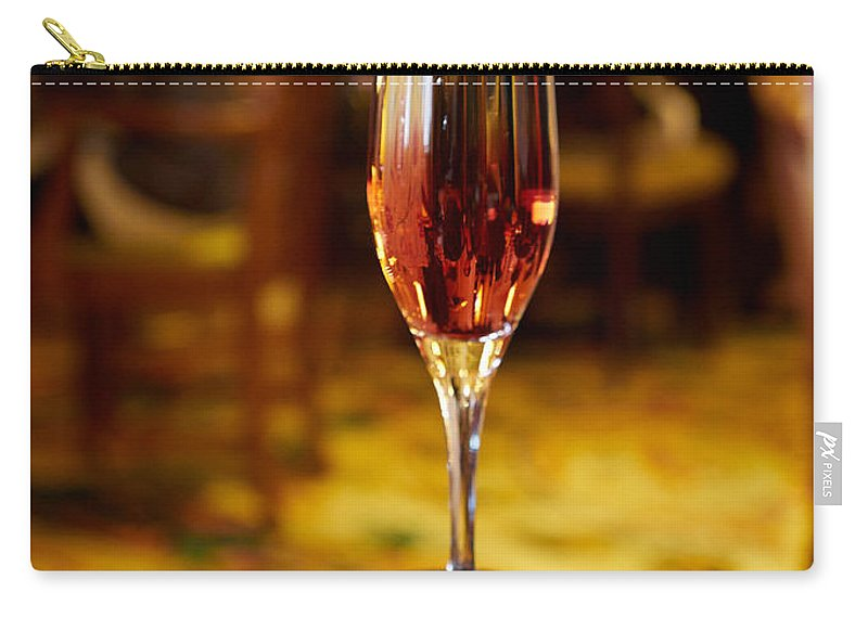 Kir Royale Carry-all Pouch featuring the photograph Kir Royale In A Champagne Glass by Louise Heusinkveld