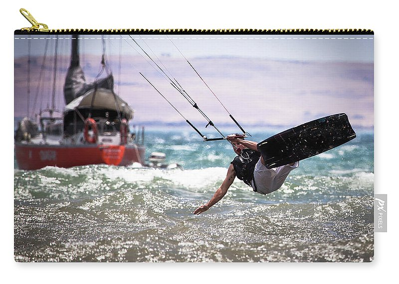 Expertise Carry-all Pouch featuring the photograph Kite Board Action by Ann Clarke Images