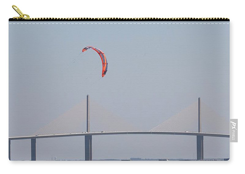 Bridge Carry-all Pouch featuring the photograph Kite Surfer And Skyway Bridge by Christiane Schulze Art And Photography