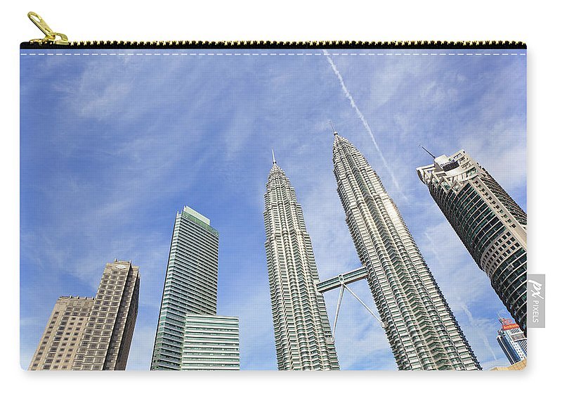 Corporate Business Carry-all Pouch featuring the photograph Kuala Lumpur Skyline by Tom Bonaventure