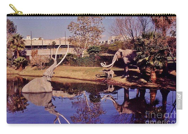 La Brea Tar Pits Carry-all Pouch featuring the photograph La Brea Tar Pits by John Malone