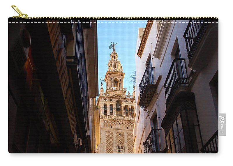 Seville Carry-all Pouch featuring the photograph La Giralda - Seville Spain by Andrea Mazzocchetti