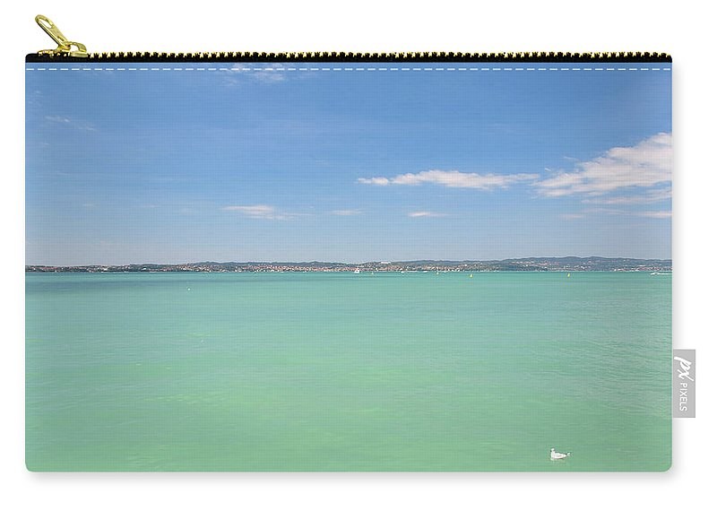 Scenics Carry-all Pouch featuring the photograph Lago Di Garda by Goranstimac