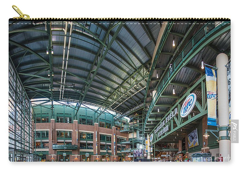 Architecture Carry-all Pouch featuring the photograph Lambeau Atrium by Andrew Slater