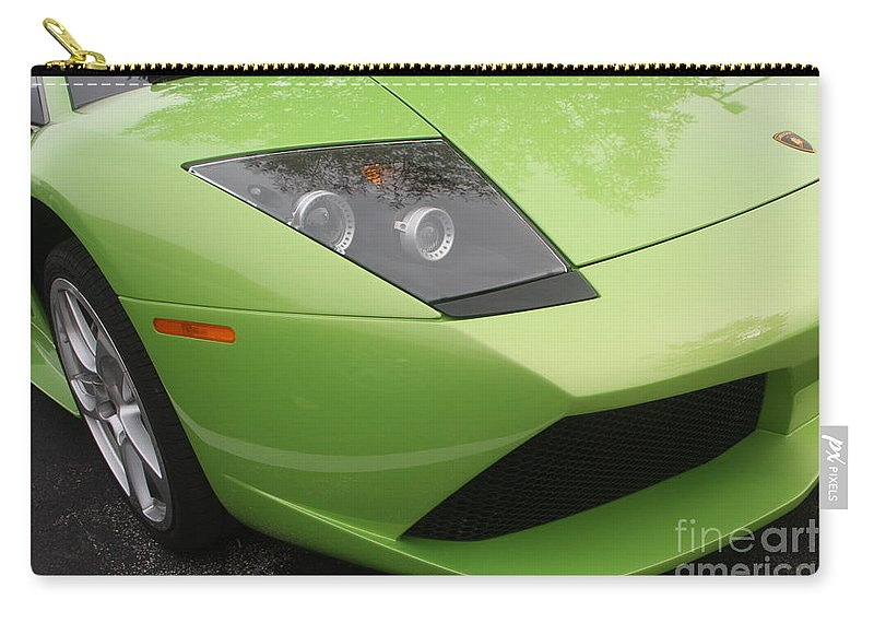 Lamborghini Carry-all Pouch featuring the photograph Lambopass8709 by Gary Gingrich Galleries