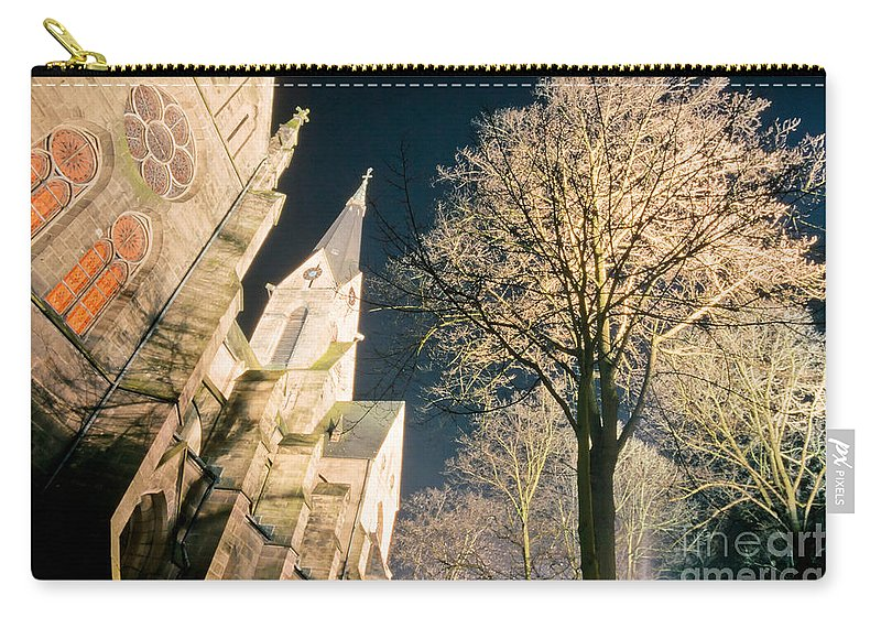 Architecture Carry-all Pouch featuring the photograph Large Stone Church At Night by Stephan Pietzko