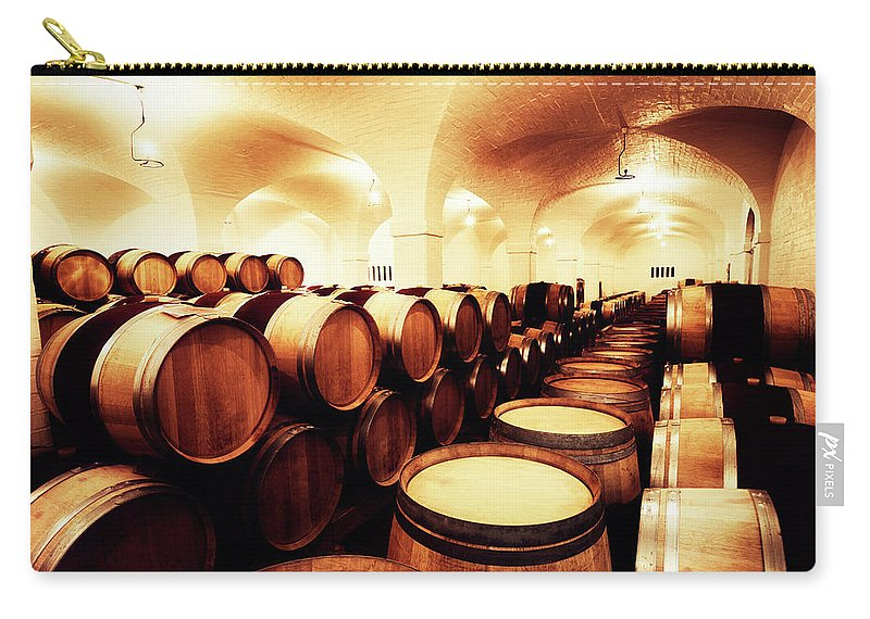 Alcohol Carry-all Pouch featuring the photograph Large Winery Cellar Filled With Oak by Rapideye