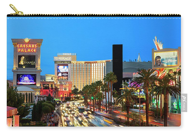 Built Structure Carry-all Pouch featuring the photograph Las Vegas Strip At Dusk With Hotels And by Sylvain Sonnet