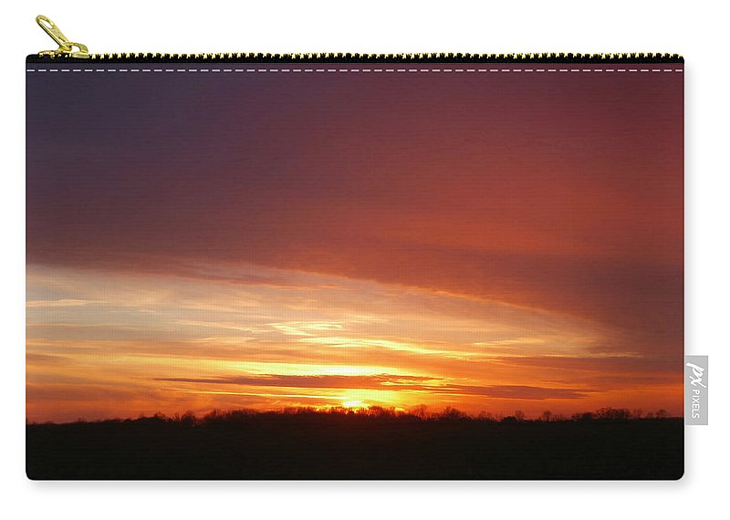 Sunset Carry-all Pouch featuring the photograph Last Sunset Of 2013 by Dan McCafferty