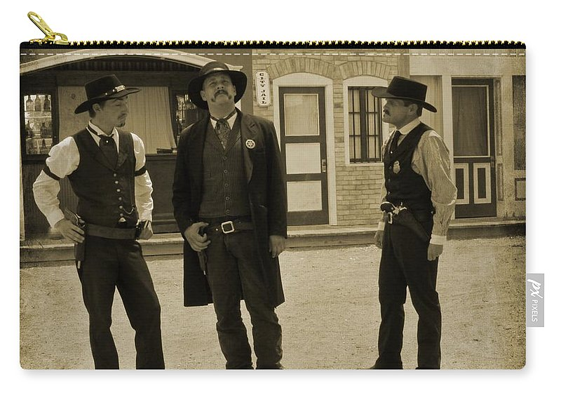 Gunslingers Carry-all Pouch featuring the photograph Let Me Think On That Fer A Minute by John Malone